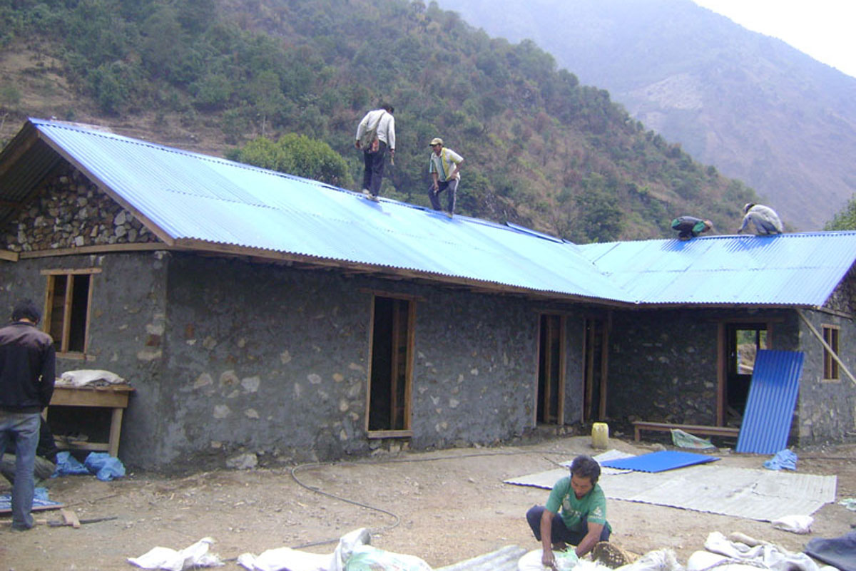 Completing roof of school, Kanchenjunga Base Camp Trek