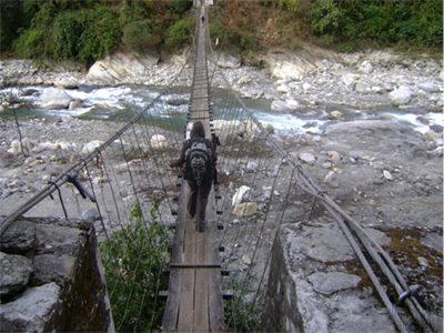 Crossing the bridge over the Modi Khola
