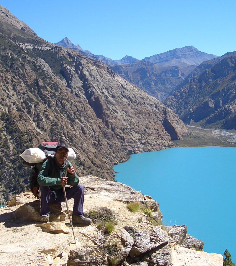 Staff at Phoksundo lake, Nepal