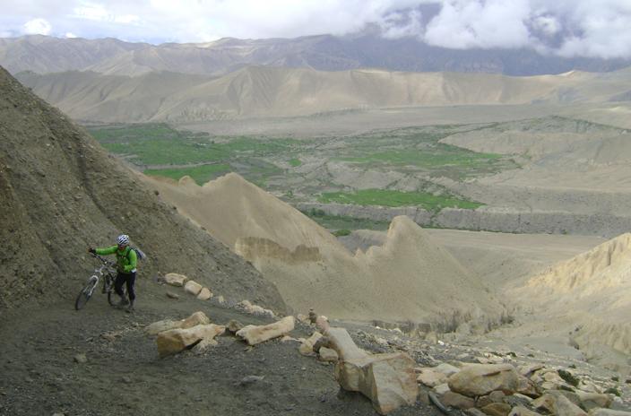 Pushing bike above Drakmar, Mustang